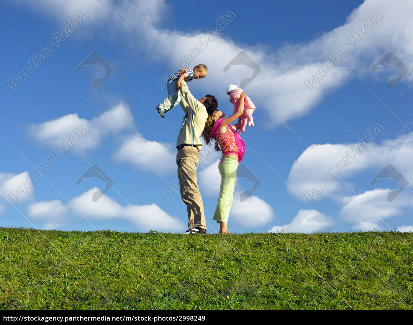 family, with, two, children, under, clouds - 2998249