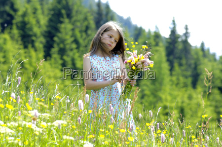 girl with bunch of flowers in