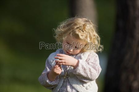 girl 3 4 holding mushroom