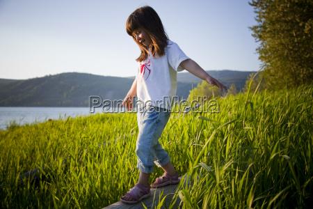 girl, balancing, on, log, near, the - 3008331