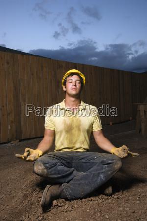 meditating construction worker