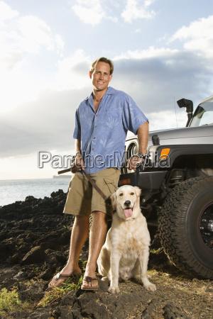 man and dog by suv at