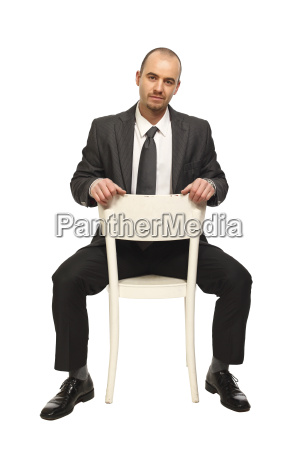 man sit on chair