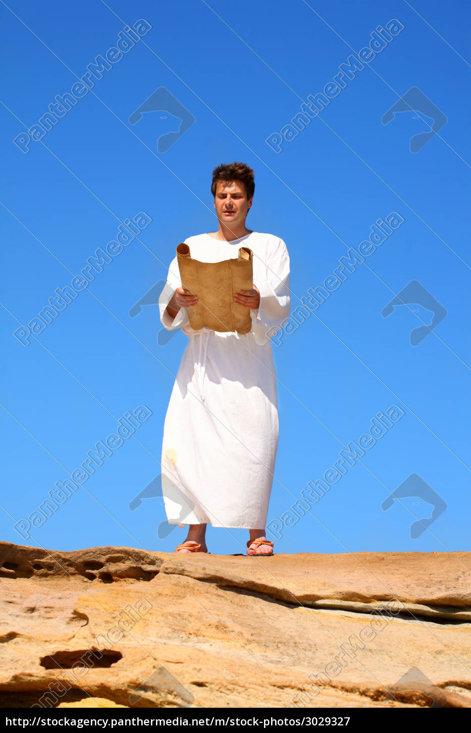 man, reading, scroll, in, rocky, desert - 3029327