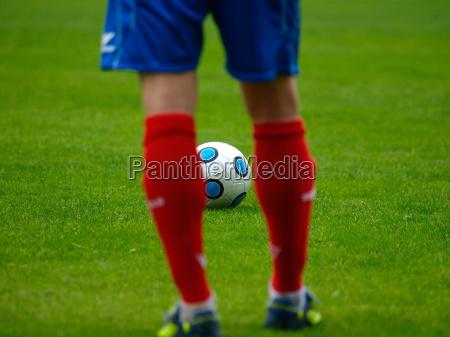 free kick on a green football