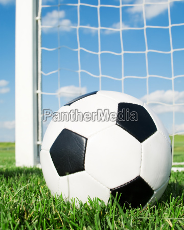 football in the goal net with