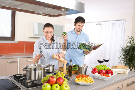 happy, couple, in, modern, kitchen, cooking - 3063835