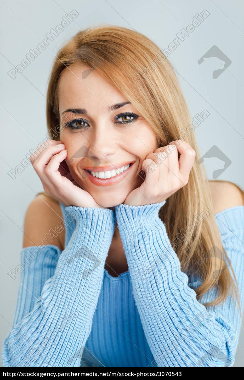 woman, looking, at, camera, and, smiling - 3070543