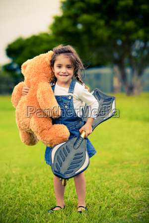 cute, girl, standing, in, grass - 3093009