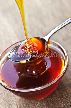honey, dripping, onto, spoon - 3096825