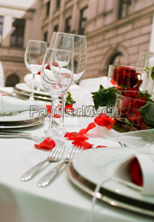 covered banquet table with rose decoration