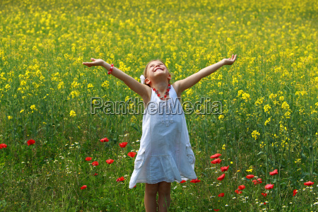 girl, surrounded, by, rapeseed, flowers - 3107565