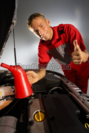 car mechanic quality checking the engine