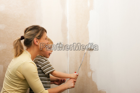 family strokes wall of new apartment