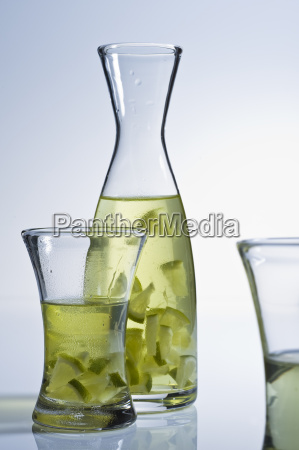 glass carafe with tea and lime