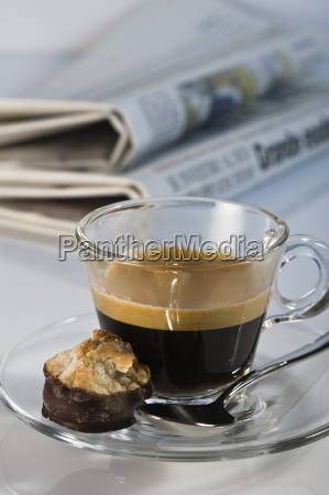 espresso in glass cup with macaroons