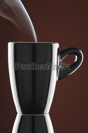 black espresso cup with steam