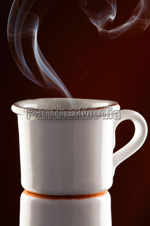 white cup with coffee steam