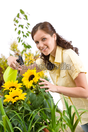 gardening woman sprinkling water on
