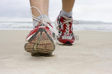 feet of a jogger on strnad