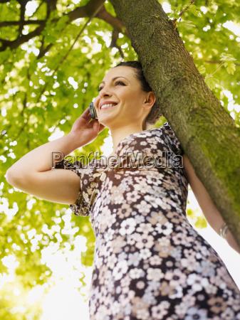woman, looking, at, camera, and, smiling - 3130693