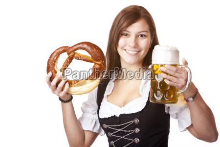 woman in dirndl holds oktoberfest beer