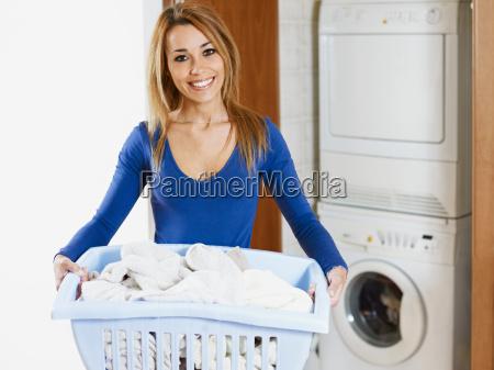woman, looking, at, camera, and, smiling - 3134625