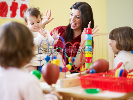 three little girls and female teacher