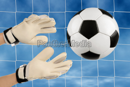 hands of a goalkeeper in action
