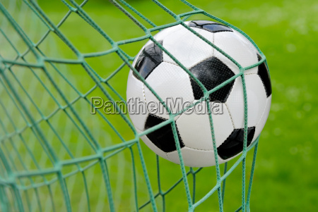 soccer ball flying into the goal