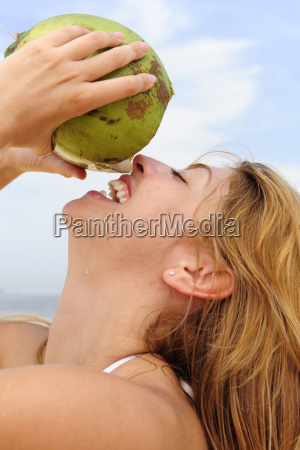 woman drinking coconut water on the