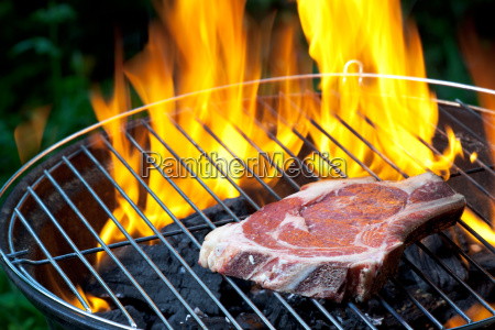 t bone steak on a grill