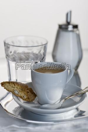 espresso in white cup with cantuccini