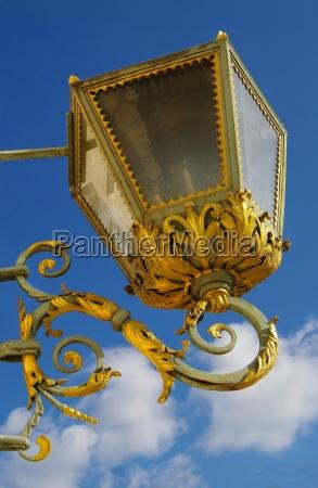 golden baroque lantern with vines