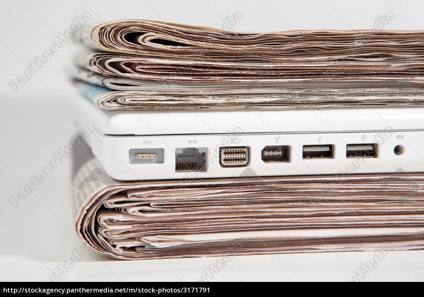 laptop, between, newspaper, pile - 3171791