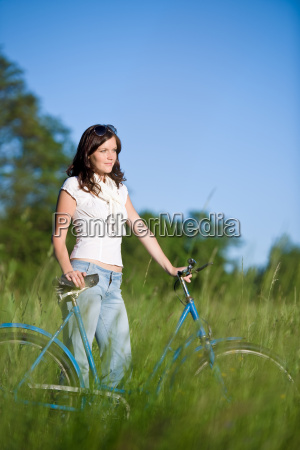 woman, with, old-fashioned, bike, in, meadow - 3172355