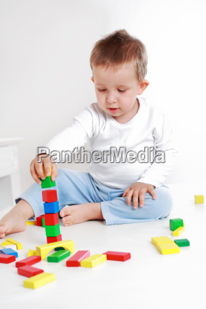 lovely boy playing with blocks