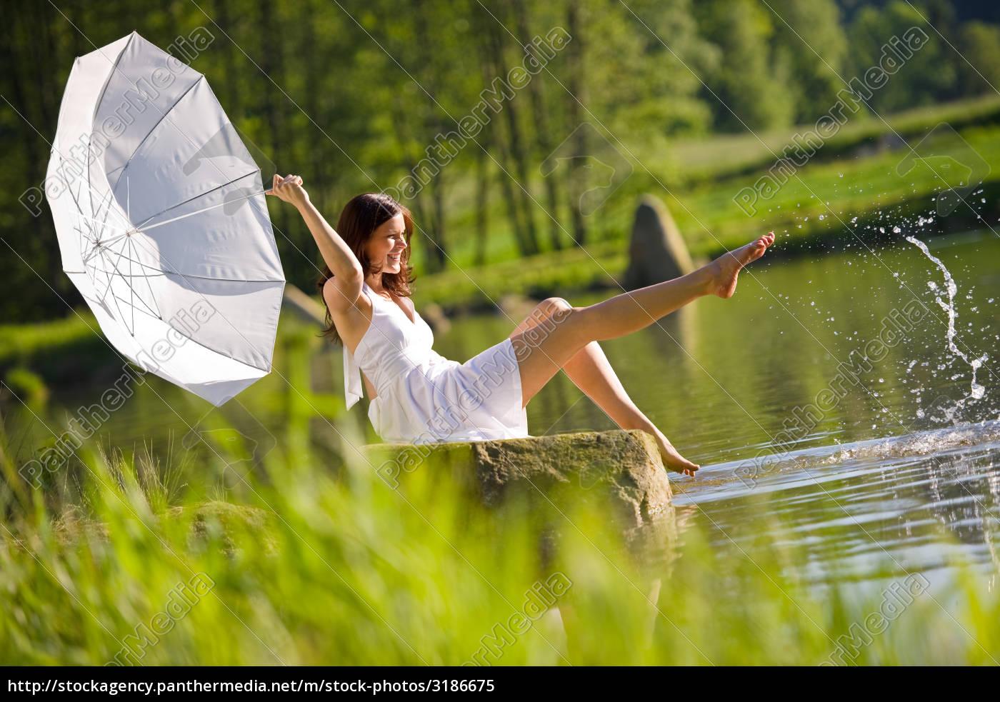happy, romantic, woman, sitting, by, lake - 3186675