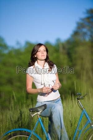 woman, with, old-fashioned, bike, in, meadow - 3186693