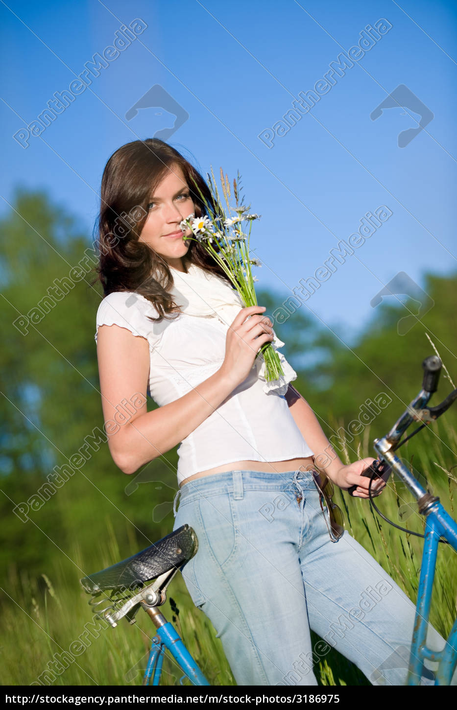 woman, with, old-fashioned, bike, in, meadow - 3186975