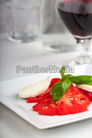 tomato mozzarella basil wine