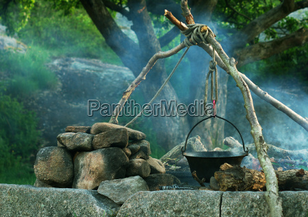 cooking in cauldron