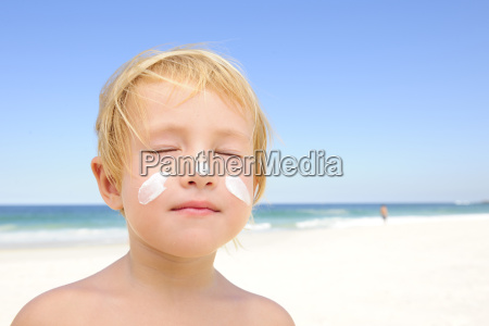 child with sunscreen on his face