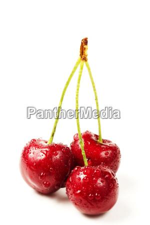 three wet cherries