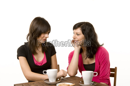 two women in conversation at the