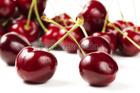two cherries in front of many
