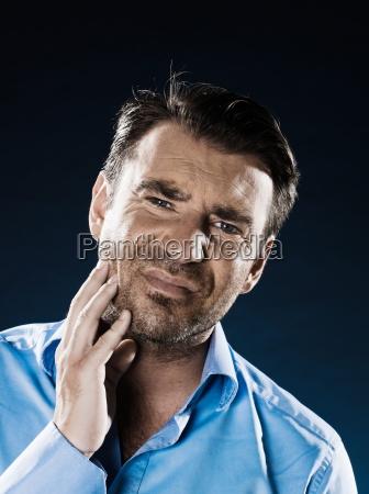 man portrait toothache