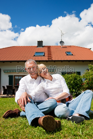 mature couple sitting in front of