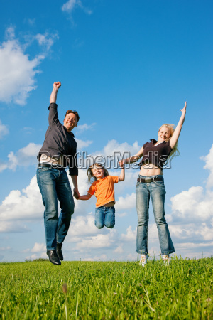 family, jumping, on, meadow, in, summer - 3285613