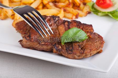 juicy pork steak with chips
